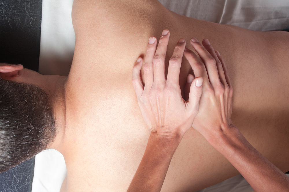 male patient getting back massage